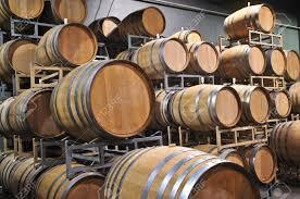 stacked oak barrels. Stacked Oak Wine Barrels In Winery Cellar Stock Photo - 5101565 T