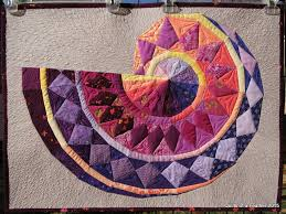 Quilts of a Feather: Pythagorean Spiral Quilt & Pythagorean Spiral Quilt Adamdwight.com