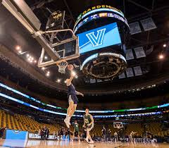 donte divincenzo of villanova shoots a layup during their practice session in td garden on march