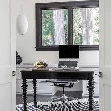 black desk with black and white zebra cowhide rug