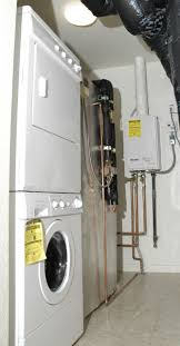 a whole house tankless gas water heater installed in a laundry room