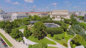 national gallery of art sculpture garden with fountain near edifices of national archive department of justice and museum of natural history at summer