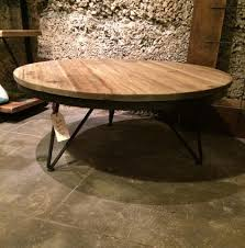 round wooden coffee table with iron legs