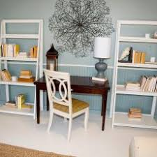 blue white office space. pale blue office area with white bookcases space