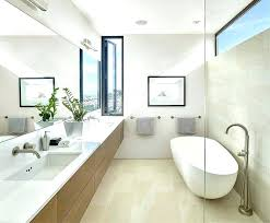 narrow bathroom narrow bathroom ideas narrow bathroom window with freestanding bathtub and small framed painting also