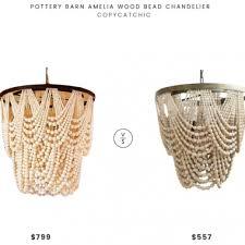 daily find pottery barn amelia wood bead chandelier