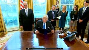 the oval office desk. donald trump at the resolute desk in oval office 25th jan 2017 desk d