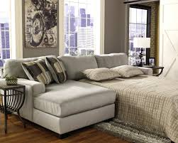 elegant family room design with cozy pottery barn sleeper sofa and ikea side table with table lamp on dark pergo flooring plus ikea sofa beds also pottery barn furniture outlet