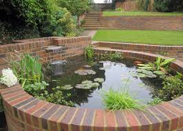 Small Picture A raised pond is integrated into the garden structure Ponds