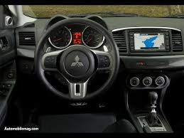 mitsubishi evo 2015 interior. from the gallery of ralliart pics that im sure weve all seen time and again take a look at yellow logo near tach as well button mitsubishi evo 2015 interior