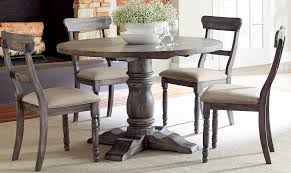 round dining table with chairs in rustic