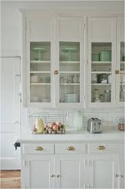 i love everything about this kitchen love the white cabinets glass door fronts latch hardware on