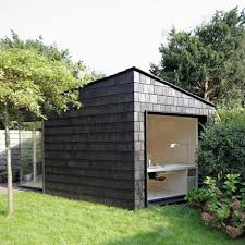 outside office shed. interesting office garden studio by serge schoemaker has a dark rough exterior and  lightfilled interior throughout outside office shed