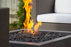stardust s paloform bento outdoor fireplace in charcoal with lava rock black