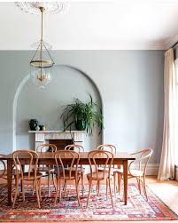 spacious dining room farmhouse table wood chairs light blue gray walls