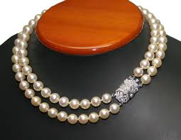 14k white gold and 1 50ct diamond clasp on cultured pearl necklace 16 length