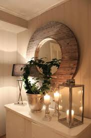 cut out the center of the spool and add a mirror for a gorgeous diy mirror for your bathroom or bedroom