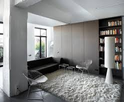 white shag rug. Interesting Library Room With Black Sofa Also Metal Chairs On White Shag Rug