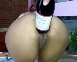 A bottle of champagne in anal