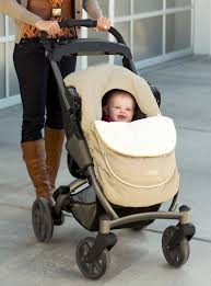 the jj cole car seat cover fits over infant carriers and standard sized strollers