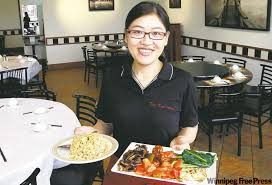 wenyang xiong a waitress at dim sum garden with fried rice dish left