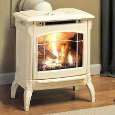 burning wood in a gas fireplace hearthstone gas stove in oyster enamel for the granary wood burning wood in a gas fireplace