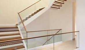 frameless glass railing with wood stairs