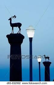 Stag Column (Symbol of Rhodes). Mandraki Harbor. Dawn. Rhodes. Dodecanese,  Greece Stock Image | d65-632992 | Fotosearch