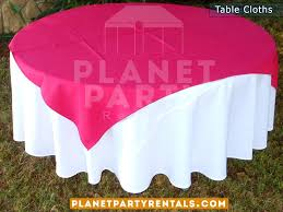 round table with white table cloth and fuchsia blueoverlay runner
