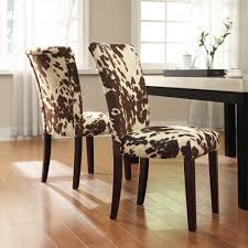 add an extra touch of personality with cow print dining room chairs they are neutral enough to work well in many spaceany styles of home decor