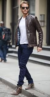 white plain tshirt styled with brown leather jacket and sunglasses