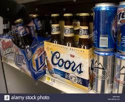 Miller Light Six Pack Six Packs Of Coors And Miller Beer On A Supermarket Shelf