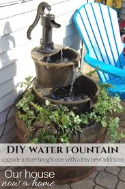 diy water fountain adding floweraking the bought water feature become a stand