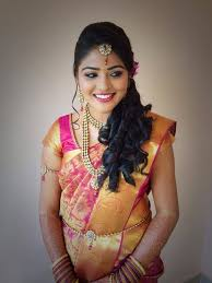 makeup back brushed hair with curls traditional south indian bride wearing bridal saree and jewellery reception