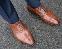 here s a pair of rtw gaziano girling in really nice leather but the fit is not perfect at least not in the arch of the foot where you can see how