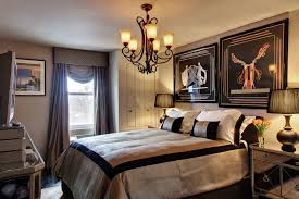 art deco bedroom bedside table black and gold accents chandelier curtains mirrored chest nightstand table bedroom