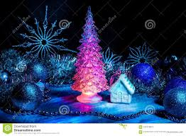 Light Pink And Blue Christmas Decorations Icy Christmas Tree Glowing With Red Light On A Blue