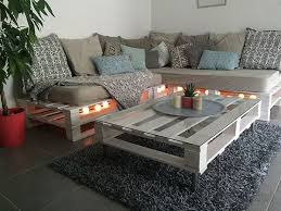 Make pallet sofa table with the favor of reused wood pallets join them,  then color these wood pallets according to your required scheme.