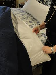 to make the quilts look plump and perfect one of our tricks is to fold them over a down comforter