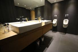 office bathroom design. keep the interior welllit with a monochromatic floor color scheme to create looks of an airy modern office bathroom that is guaranteed please design