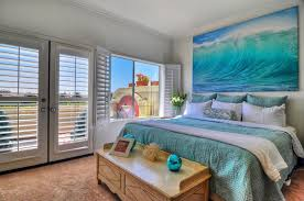 Delightful Bedroom With Ocean Wall Art, Teal Bed Covers And White Plantation Shutters
