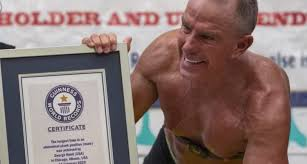 62 Year Old Former Marine Sets Plank World Record, Holds for 8 Hours and 15  Minutes - BarBend