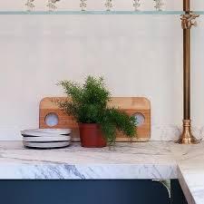 blue kitchen cabinets with brass details