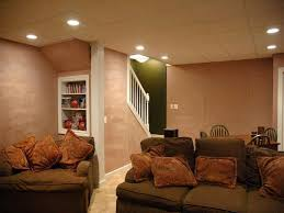 Lavish Sectional Sofa And Brown Pillows Also Basement Lighting Ideas