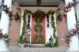 how to hang garland around front doorPorch Decorated for Christmas with Three Wreaths on Door and