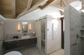 using the sliding barn door for the toilet closet in the master bathroom design