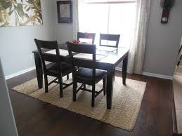 image of area rug under dining room table legs