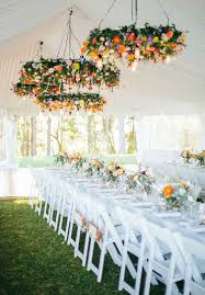 super bold flower chandeliers are amazing for a fall wedding reception make several of them