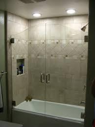 white acrylic bathtub with glass doors having stainless steel bathtub glass doors