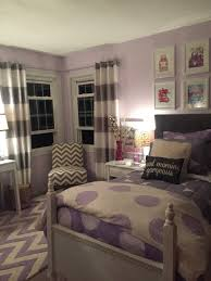 bedroom white ceiling wooden simple bed cream floor bedside table stainless lamp purple striped carpet